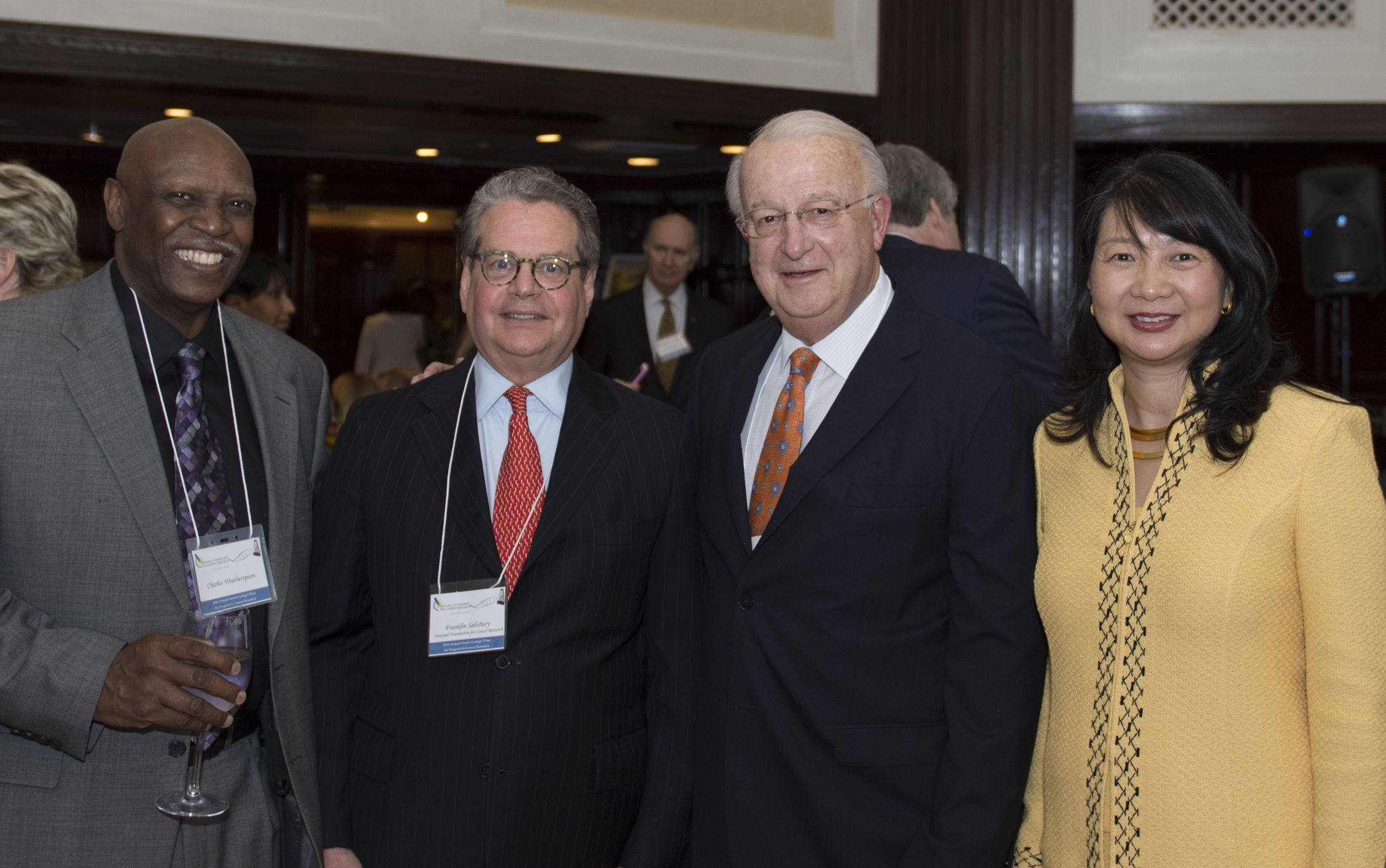 NFCR supporters L-R, Charles Weatherspoon and Gordon J. Peterson, share their support with NFCR CEO Franklin Salisbury and NFR President, Dr. Sujuan Ba