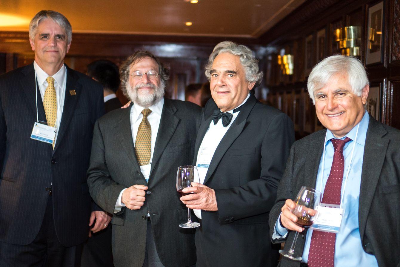 Drs. Jensen, Ravetch, Croce and Tsichlis enjoying the reception