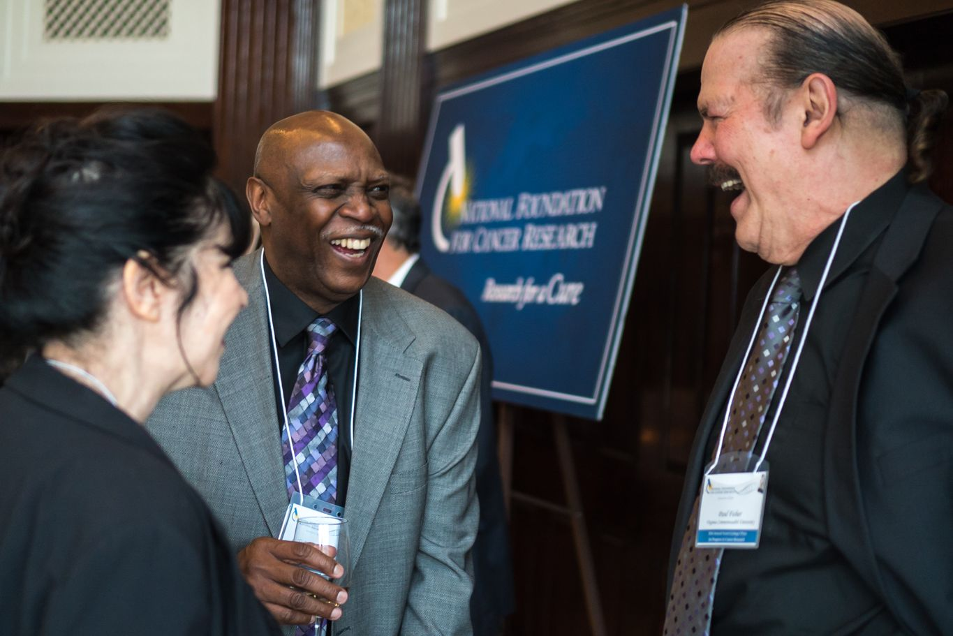 NFCR scientist Dr. Paul Fisher and his wife Marlene are all smiles with Mr. Charles Weatherspoon