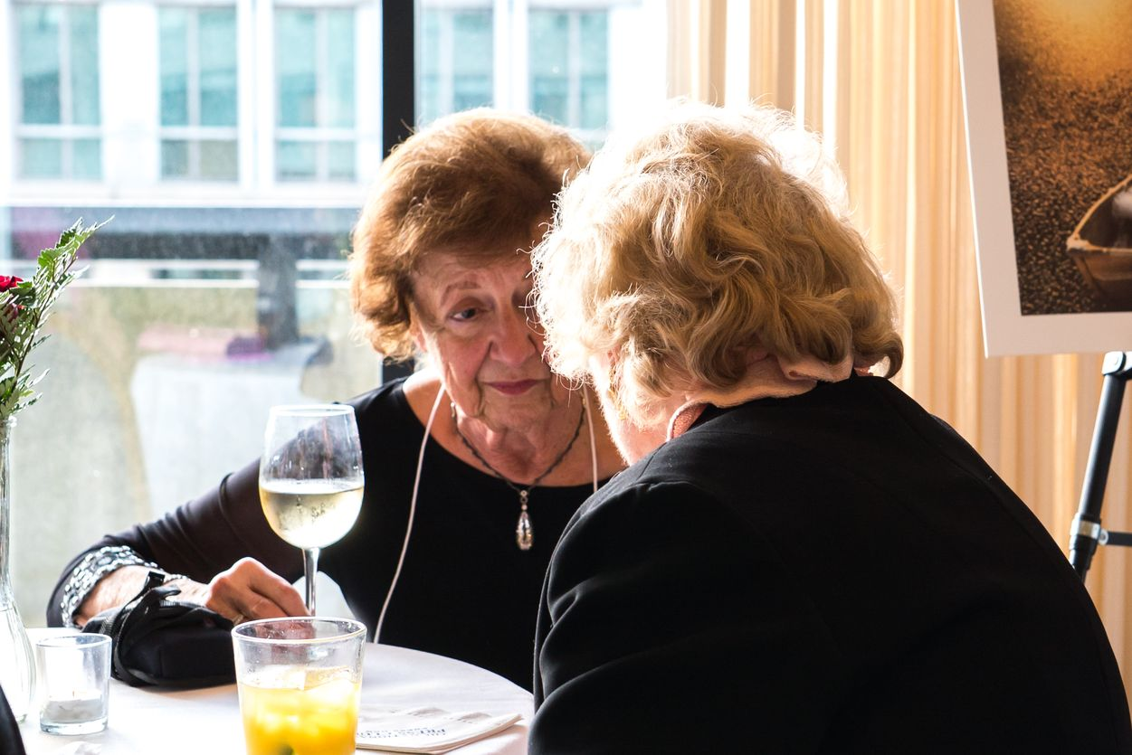Two loyal donors, Ms. Betty Locke from California, is captivated by Nancy Cole of Bethesda