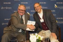 Collegial spirit extraordinaire, CEO SynerGene Joe Harford and NFCR scientist, James Basilion
