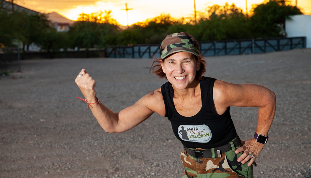 Cancer Boot Camp Creator flexes her arm