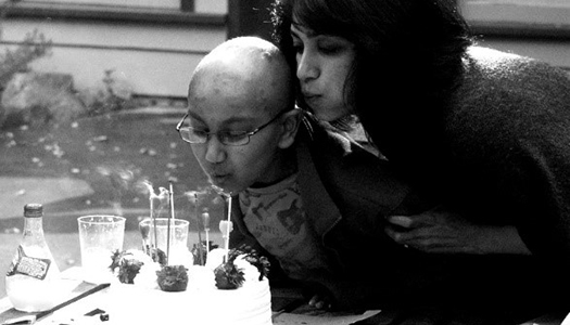 Purvi and Amaey Shah blow out candles on a birthday cake