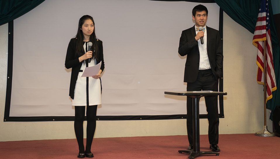 Tina Zhang and her Youth Art Bridge Teammate address the audience at their fundraiser for cancer research